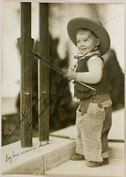 Untitled (Proof Print: Boy In Cowboy Outfit Holding Arrow)