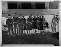 Untitled (Uhland Fair, Group Of Men And Women Standing Outside Tent)
