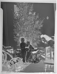 Untitled (Mother And Two Children With New Toys In Front Of Christmas Tree)