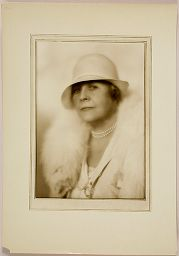 Untitled (Portrait Of A Woman In White Cloche Hat, Pearls And White Fur Stole)