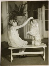 Untitled (Proof Print: Young Girl With Dog On Hind Legs On Bench)