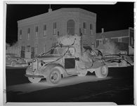 Untitled (truck towing high school class float)