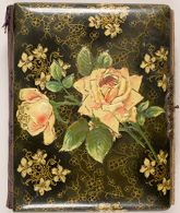 Untitled (family album with rose-adorned cover)