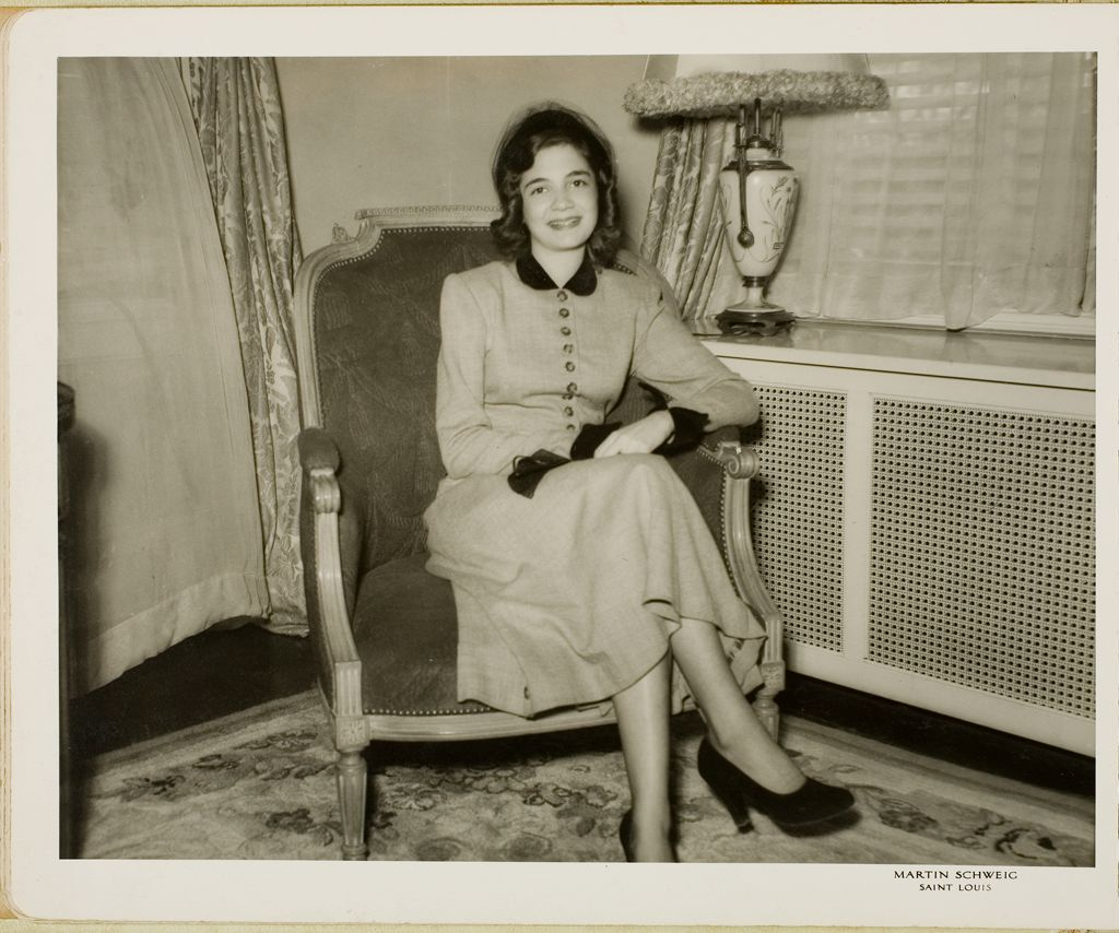 Untitled (Smiling Woman Seated In Chair)