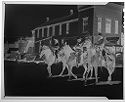Untitled (Three People On Horseback Riding Down Town Street)