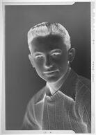 Untitled (studio portrait of teenage boy wearing sweater)