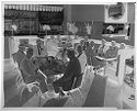Untitled (Men Posed Sitting Around Tables In Restaurant)