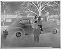 Untitled (Man Posed Lifting Up Woman Next To Car Outdoors)