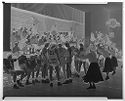 Untitled (View From Court Of Basketball Players And Cheerleaders During School Ame With Audience Watching In Background)