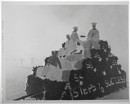 Untitled (High School Students Sitting On Parade Float At Night)