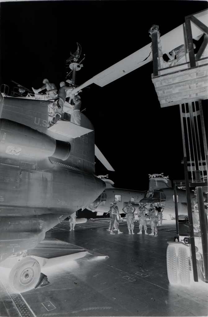 Untitled (Soldiers Working On Rotor Of Chinook Helicopter, Vietnam)