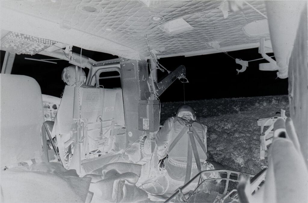 Untitled (Sp5 Charles Alden Assists Soldier On Hoist Outside Medevac Helicopter, Vietnam)