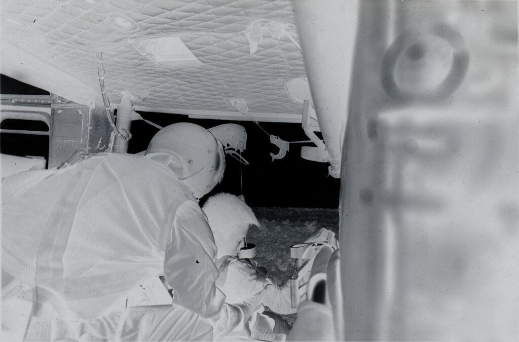 Untitled (Sp5 Charles Alden Helps Arvn Soldier Off Hoist Into Medevac Helicopter, Vietnam)