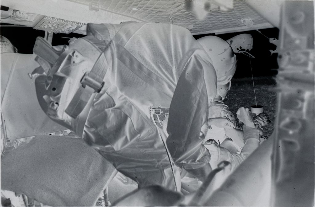 Untitled (Member Of The 57Th Medical Detachment Helps Soldier Off Hoist And Into Medevac Helicopter, Vietnam)
