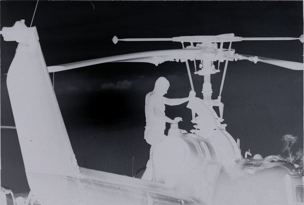 Untitled (Soldier Working On Helicopter, Vietnam)