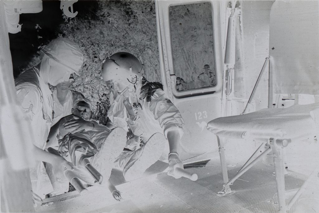 Untitled (Members Of 57Th Medical Detachment Loading Wounded Soldier Into Medevac Helicopter, Vietnam)