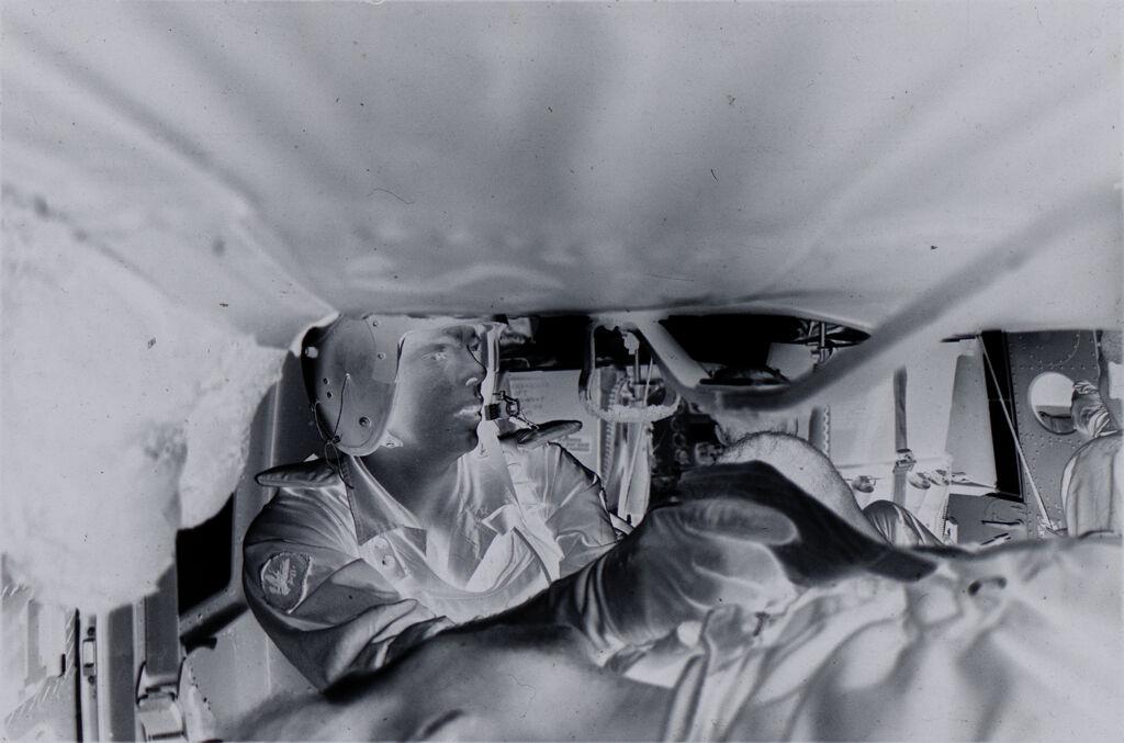 Untitled (Sp5 Herbert Donaldson Treating Wounded Soldier Inside Medevac Helicopter, Vietnam)