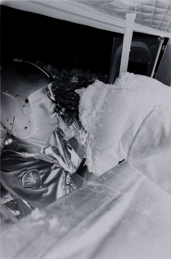 Untitled (Sp5 Herbert Donaldson Loading Wounded Soldiers Into Medevac Helicopter, Vietnam)