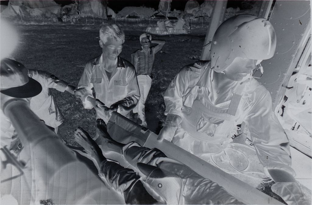Untitled (Member Of 57Th Medical Detachment And Arvn Medics Loading Wounded Soldier Into Medevac Helicopter, Vietnam)