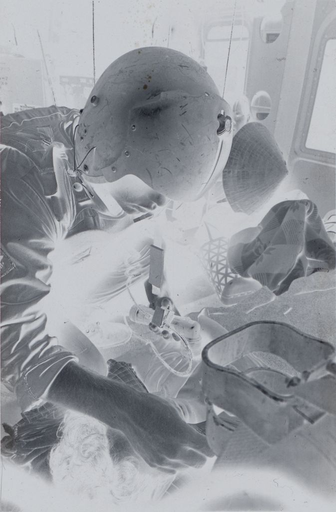Untitled (Member Of 57Th Medical Detachment Treating Wounded Soldier Inside Medevac Helicopter, Vietnam)