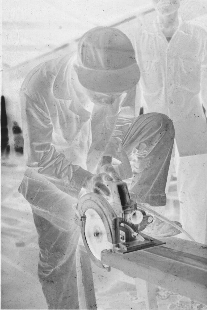 Untitled (Vietnamese Soldier(?) Working With Circular Saw, Vietnam)