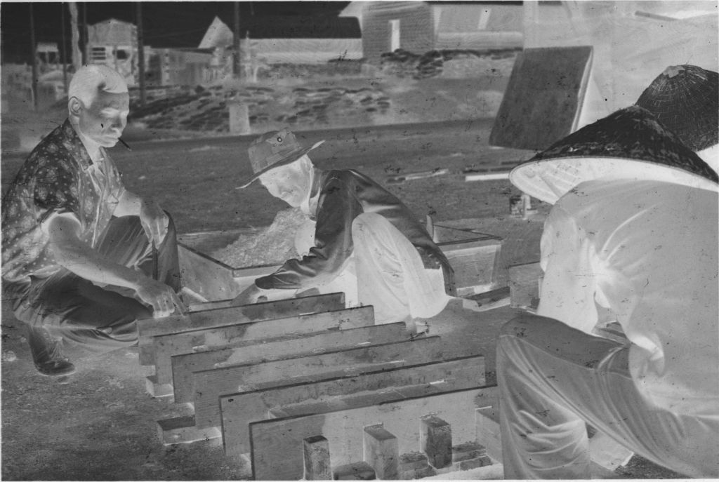 Untitled (Three Men Building Wooden Frame, Vietnam)