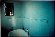 Self-Portrait in blue bathroom, London