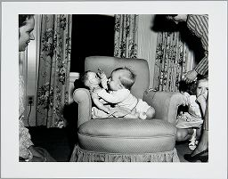 Untitled (Baby With Baby Doll On Arm Chair)