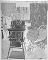 Untitled (Baby Wearing Dress Posed Sitting In High Chair Next To Stroller)