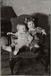 Untitled (Young Boy And Girl Sharing Chair)