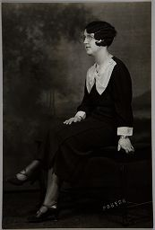 Untitled (Woman In Dark Dress With Large White Bow At Neck, Seated In Profile)
