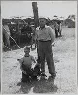 Untitled (boy kneeling with turkey, man standing by)