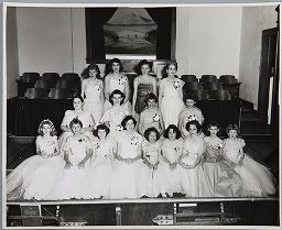 Untitled (Girls' Auxiliary Members In Corsages, Posed In Front Of Pews)