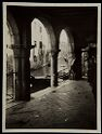 Untitled (View Of Canal, Gondola, And Building Opposite From Enclosed Walkway With Arched Openings, Venice, Italy)
