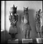 Kafir grave effigies.  Man standing, with ceremonial axe on shoulder.  Woman standing, with horned head-dress