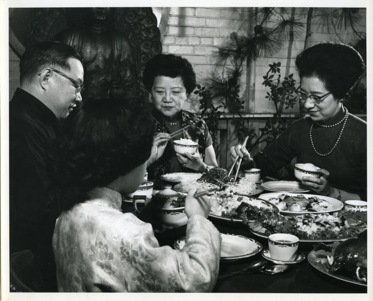 Grace Zia Chu dining with friends, c. 1965