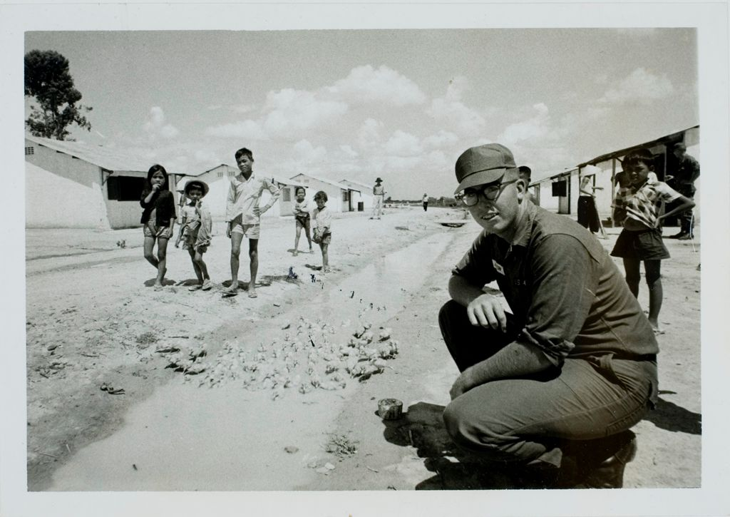 Quick To Learn His New Job, Private First Class Richard W. Ashton Observes Some Of The Ducks Which He Purchased And Distributed To The Villagers To Get Them Started.  He Passed Out 1100 Ducklings With The Condition That They Would Return Half The Price Of The Ducks When They Sold The Ducks, Allowing Him To Repeat The Procedure. (U.s. Army Photo)
