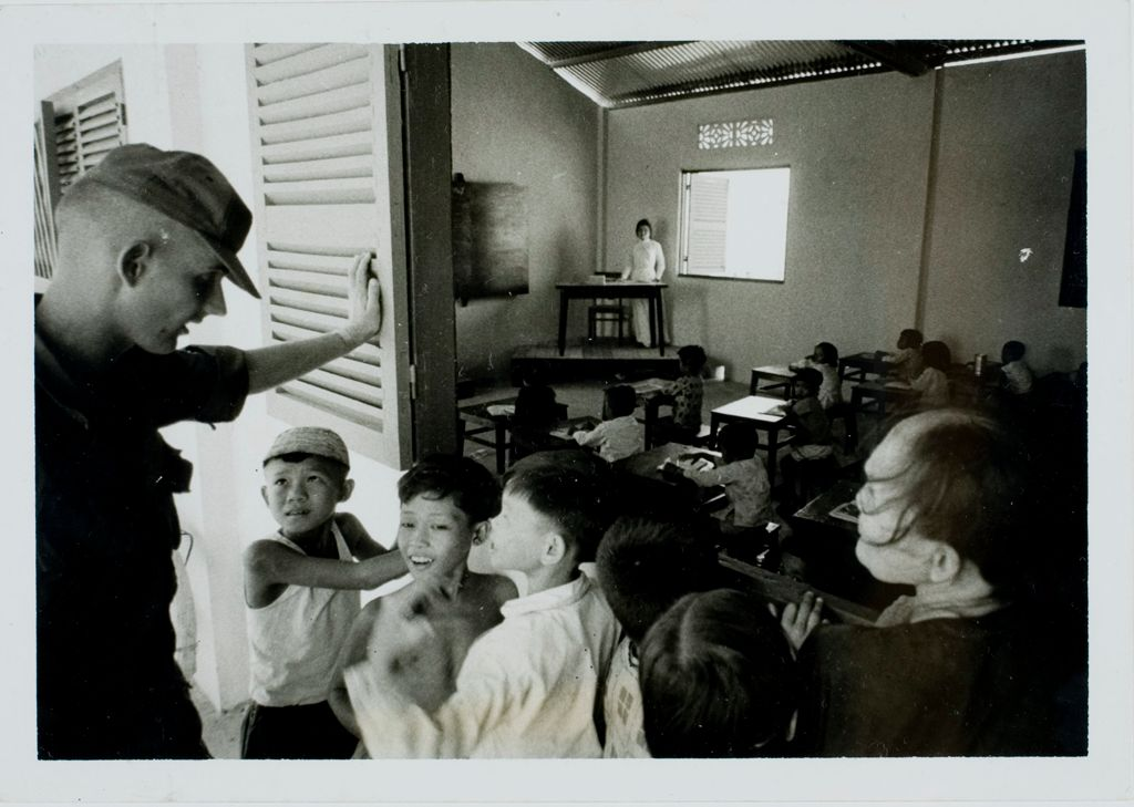 Untitled (Soldier And Village Children Outside Classroom, Gadsden Village, Vietnam)
