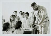 Untitled (U.S. soldier and Vietnamese children in classroom, Vietnam)