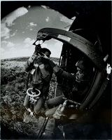 Untitled (Sp5 Charles Alden Helping Arvn Soldier Off Hoist Into Medevac Helicopter, Vietnam)