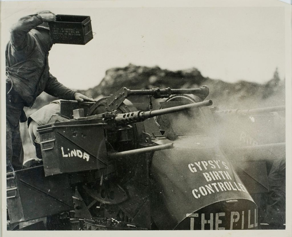 "Untitled (Soldiers Loading A Firing Heavy Artillery Stenciled ""Gypsy'S Birth Controller: The Pill"" And ""Linda,"" Vietnam)"