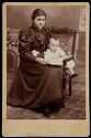 Untitled (Unidentified Woman, Seated, With Book And Child)