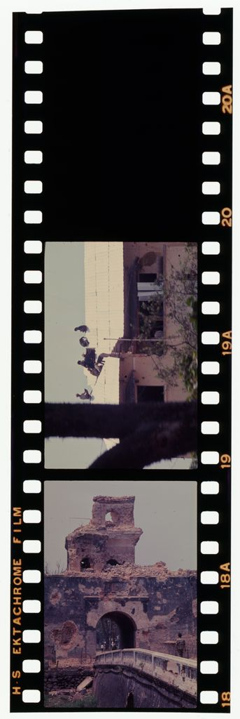 Untitled (Damaged City Gate; Building With Men On Roof, Hue, Vietnam)