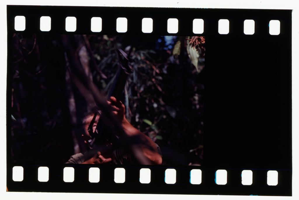 Untitled (Soldier Aiming Gun Into Trees During Fighting In Central Highlands Near Dak To, Vietnam; [Blank])