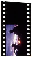 Untitled (Soldier With Gun On Shoulder And Officer Silhouetted Against Setting Sun And Clouds, Vietnam; [Blank])