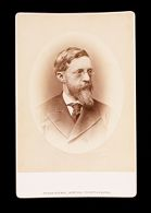 Untitled (bust length portrait of man with beard, wearing glasses, labeled Hill)