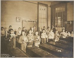 Education, Industrial: United States. New York. New York City. Vacation Schools:New York City Public Schools. Examples of the Adaptation of Education to Special City Needs: Vacation Schools: Public School No.32 Brooklyn: Fret Sawing..   Social Museum Collection