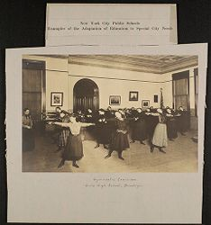 Education, Popular Culture: United States. New York. New York City. Public Schools, Adaptation to Special City Needs: New York City Public Schools. Examples of the Adaptation of Education to Special City Needs: Gymnastic Exercises. Girls' High School, Brooklyn..   Social Museum Collection