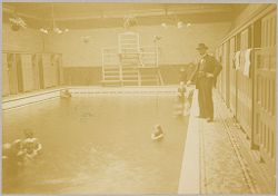 Health, Baths: Great Britain, England. London: Lambeth Baths: Social Conditions in London, England, 1903: Lambeth Baths - Teaching children how to swim with apparatus.   Social Museum Collection