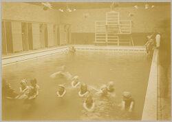 Health, Baths: Great Britain, England. London: Lambeth Baths: Social Conditions in London, England, 1903: Women's swimming pool at Lambeth Baths - School children having swimming lesson.   Social Museum Collection